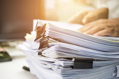 Stack of paperwork on desk