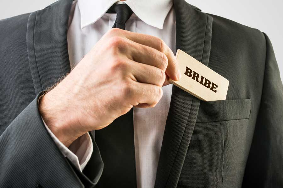 Man putting bribe in pocket