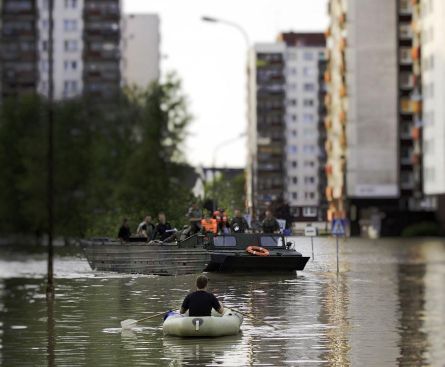 man rowing boat on street