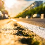 Sun shinning on damaged asphalt road after earthquake