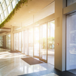 Sun shining through glass wall of modern office building