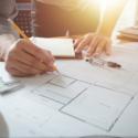 Designer Builder going over architectural plans