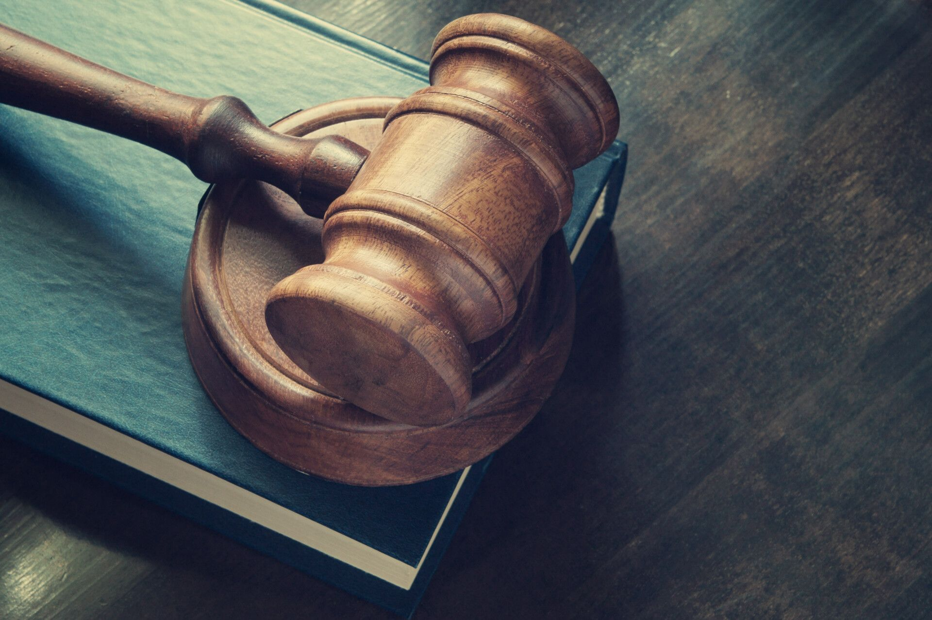 Image of a wooden gavel on top of a book