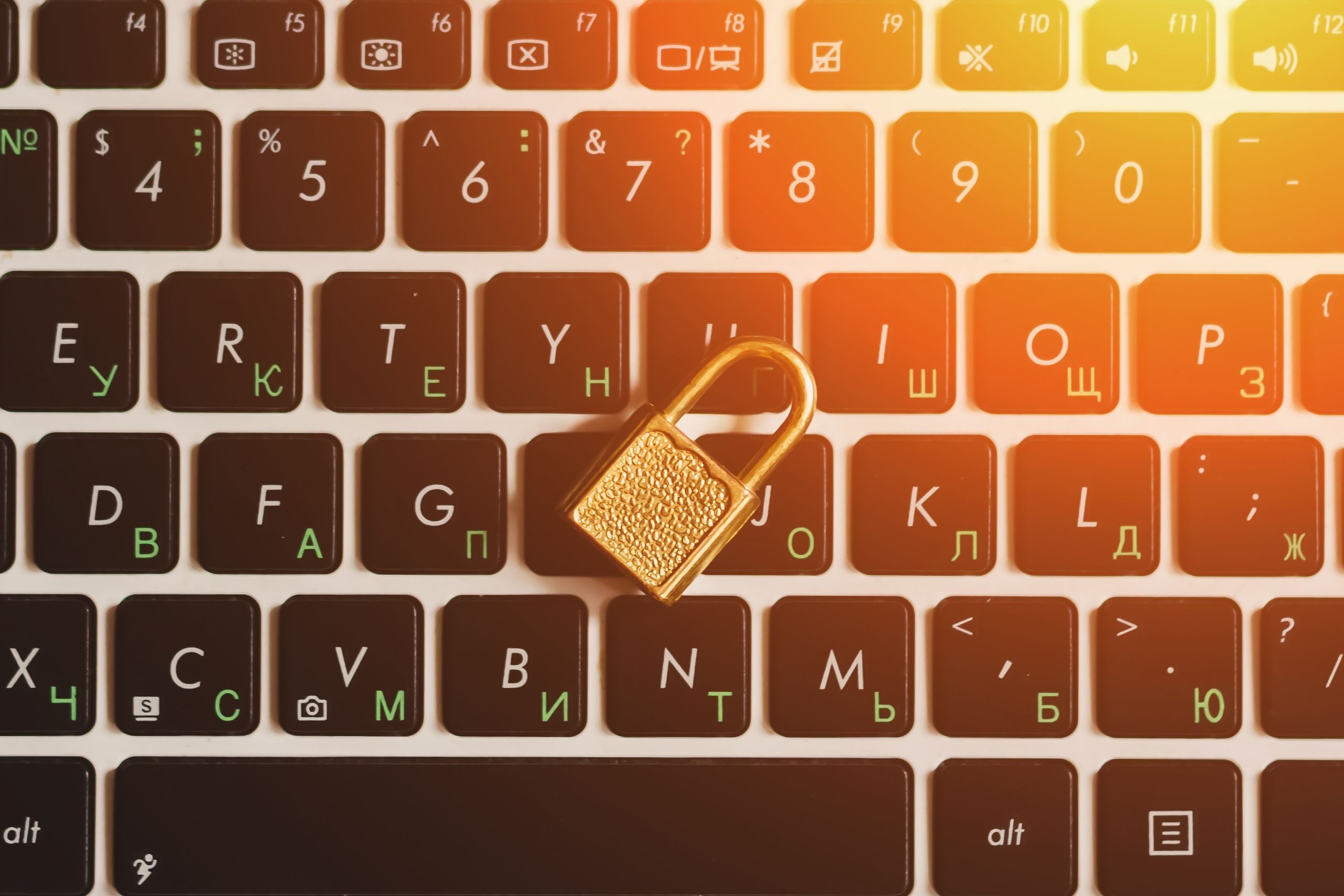 Keyboard with padlock illustrating cyber liability insurance.