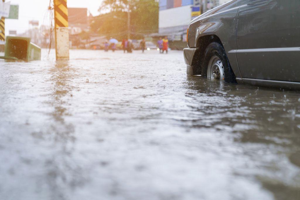 Flood waters rising in street