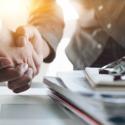 Closeup of handshake over desk