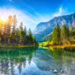 Beautiful scene of trees near turquoise water of Hintersee lake