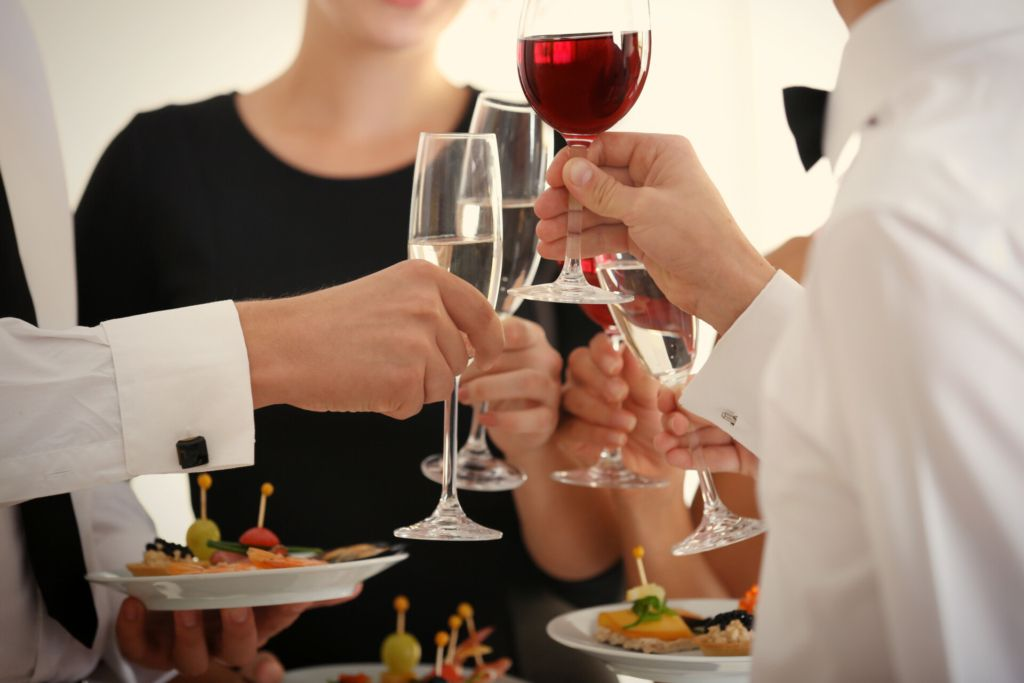 Image of employees drinking wine at a reception