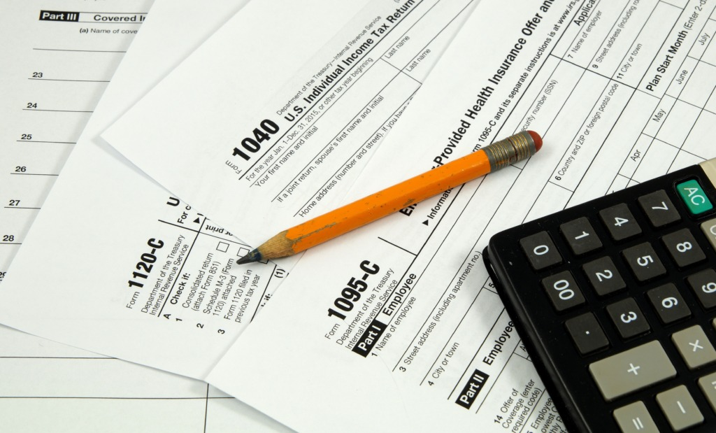 Image of tax forms, including the 1095-C