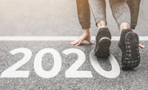 Runner at starting line of race, with 2020 painted on the ground
