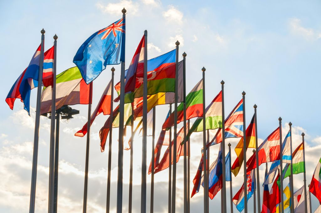 image of flags from many countries being flown