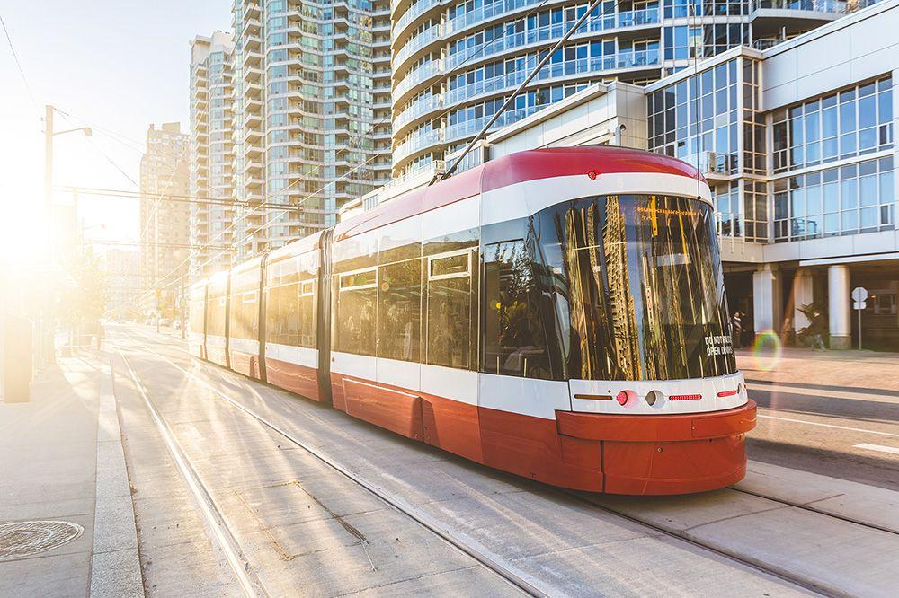 Modern commuter tram traveling downtown