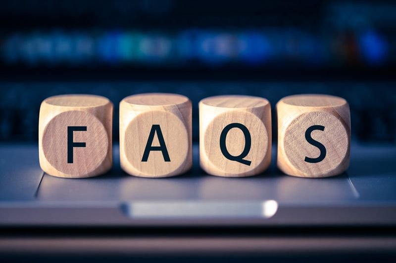 """Blogs on a computer keyboard spelling """"FAQs"""""""