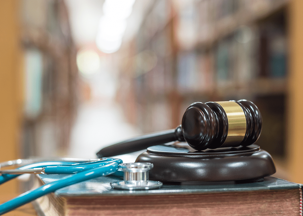 image of gavel and stethoscope with books