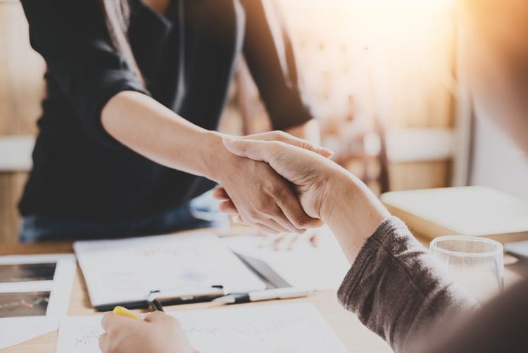 Handshake over business contracts