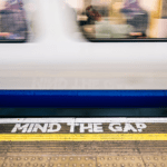mind the gap sign and subway train