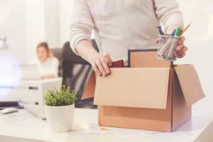 Employee packing up boxes due to employment termination