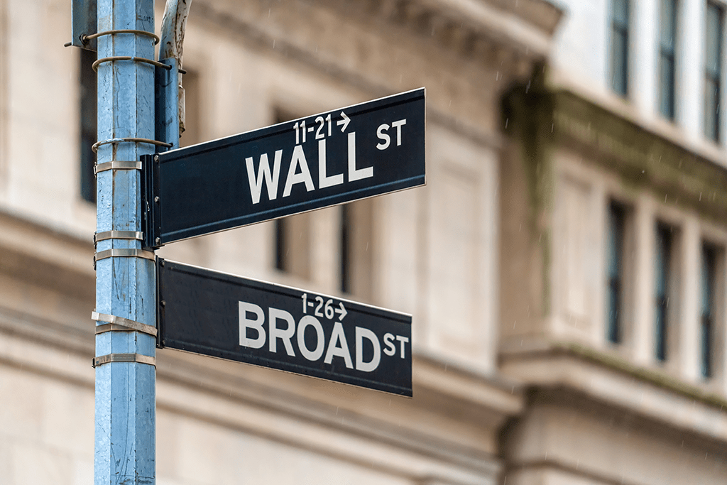 image of the street signs for broad street and wall street