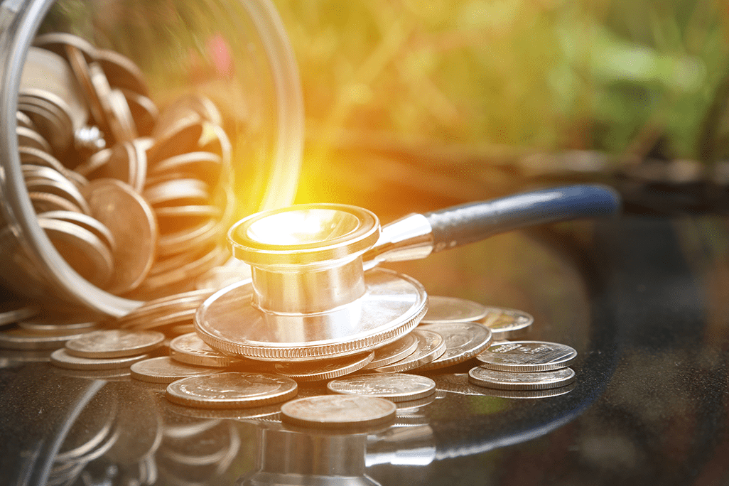 stethoscope money coins savings