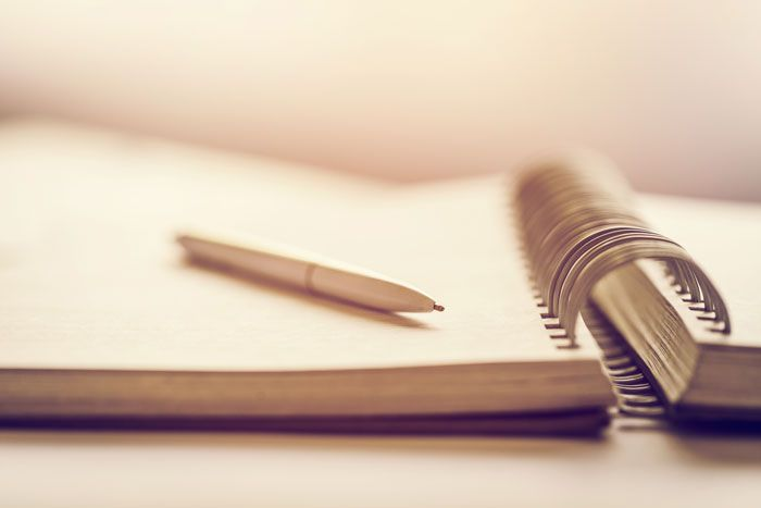 Notepad and pen on desk