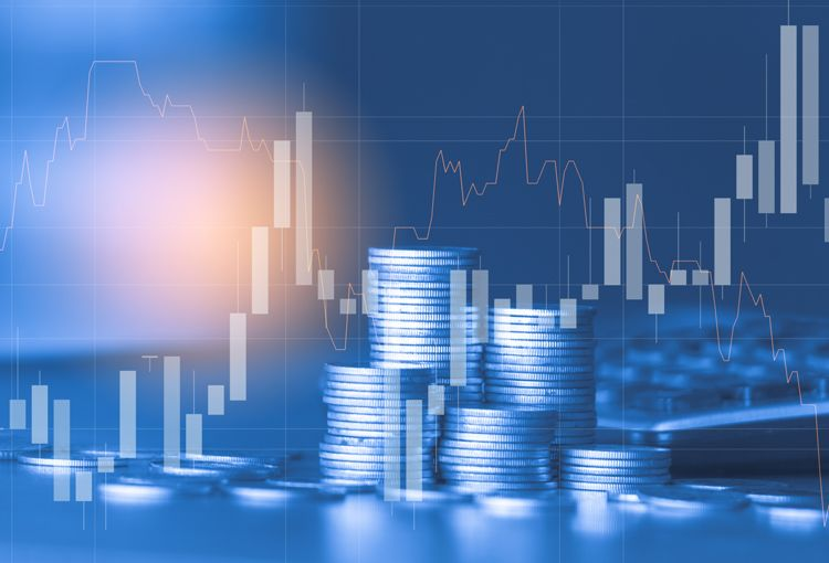 Stacked coins with stock market activity overlay