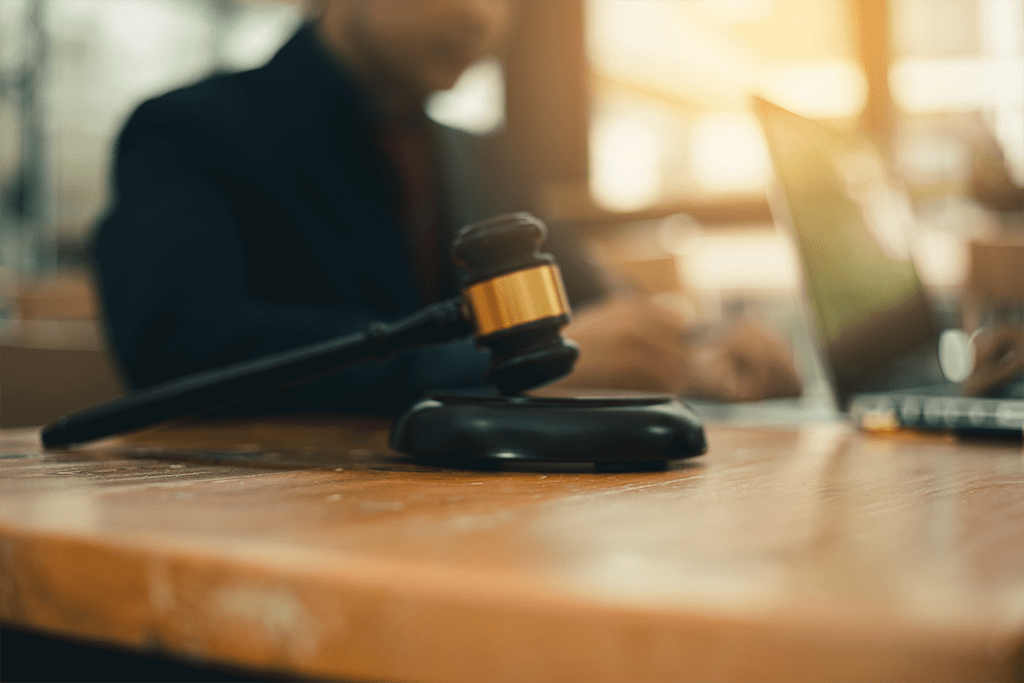 image of a gavel on desk with blurred background