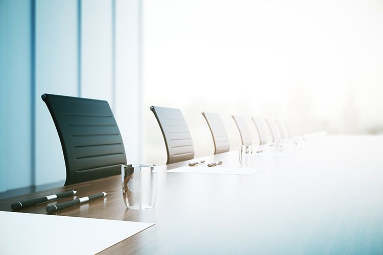 Boardroom in modern office building with sun shining through window