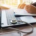Laptop clipboard paperwork stethoscope