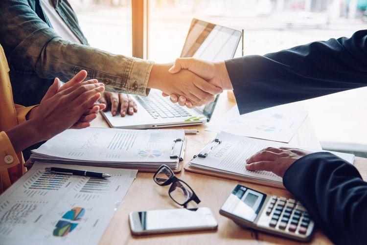 Business deal hands paperwork 2