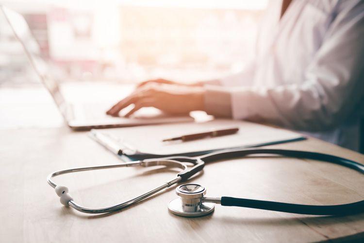 stethoscope laptop doctor