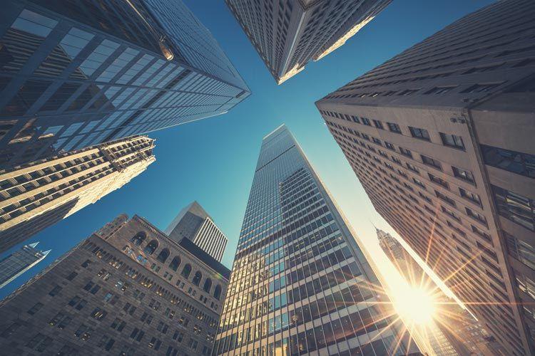 Buildings sky sunflare