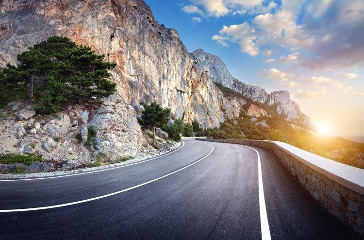 winding mountain road sunset