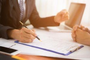 businessman client pen paperwork