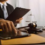 Lawyer reading tablet gavel scale laptop