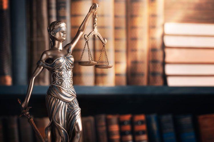 justice statue book shelf