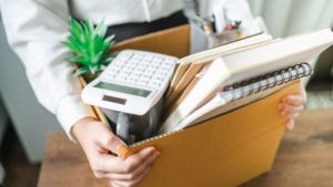 Employee resigning and packing office supplies
